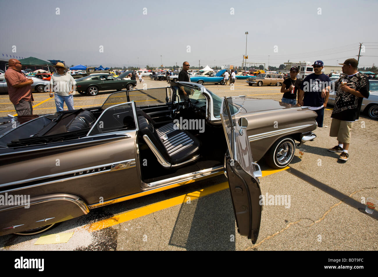 Admiring an Impala, Pomona Swap Meet for the antique auto enthusiast - Stock Image