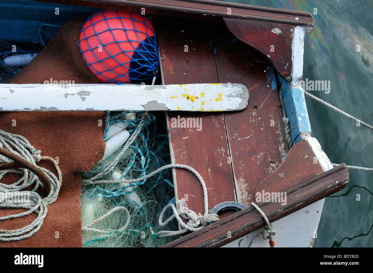 fishing boat detail northumberland oar net anchor wood old weather beaten - Stock Image