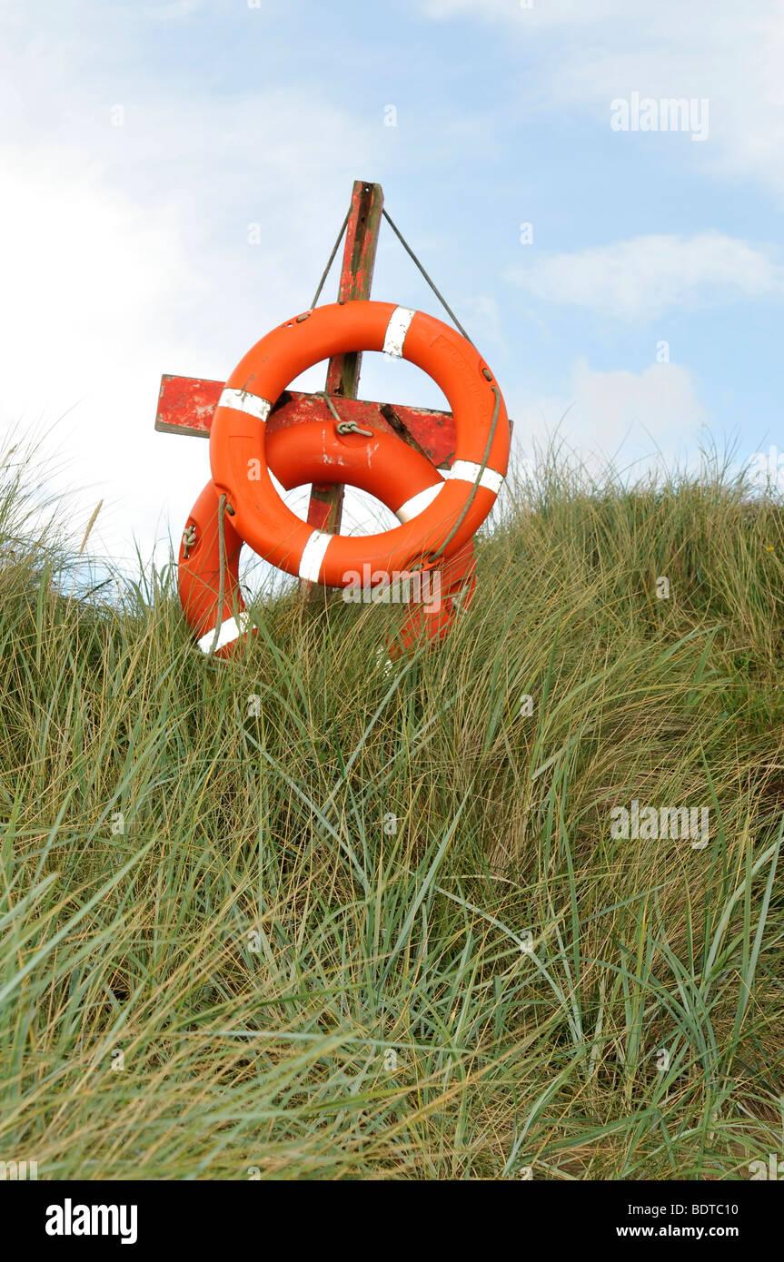 life saver bouy aid rescue swimming coast swimming bathing seaside danger - Stock Image