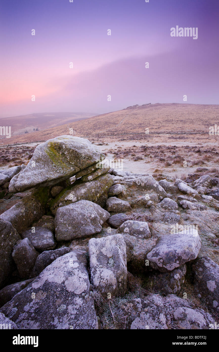 A foggy and frosty morning at the gates of megalithic Grimspound, Dartmoor National Park, Devon, England. Winter - Stock Image