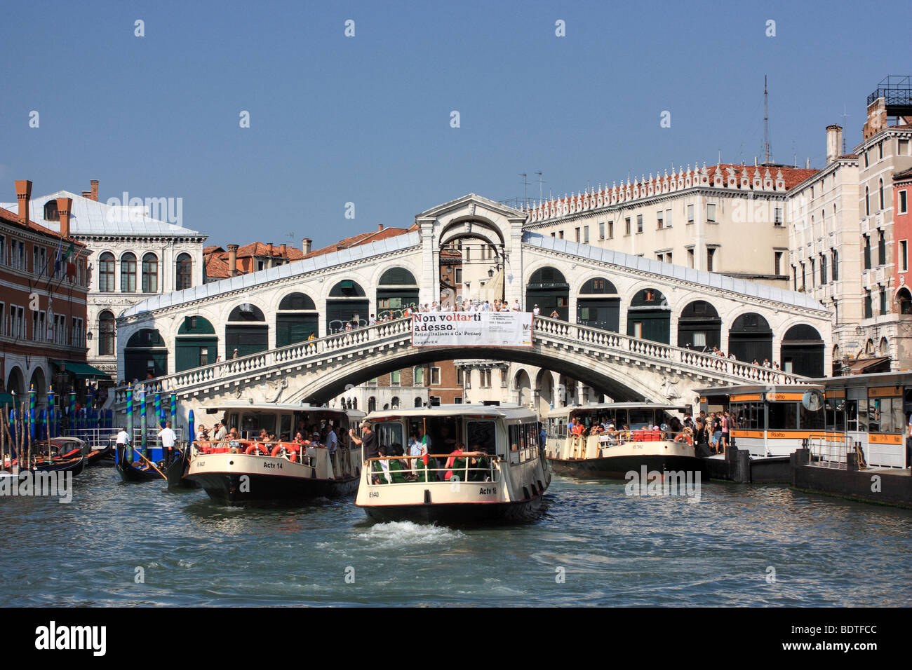 Crowded Vaporetti (water buses) traffic - Stock Image
