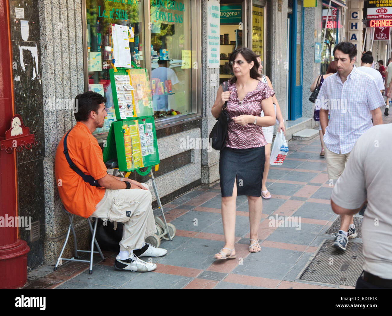 Blind lottery ticket seller working in street Fuengirola, Costa del Sol, Malaga Province, Spain - Stock Image