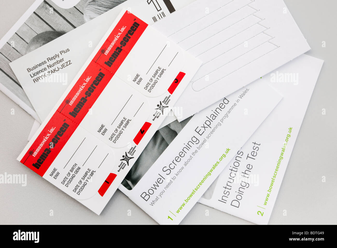 UK Bowel cancer screening kit from National Health Service Wales. - Stock Image