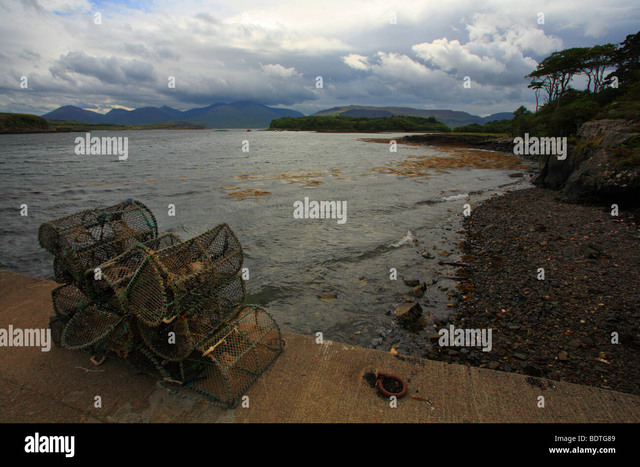A view from the Ulva ferry jetty down the Sound of Ulva, looking towards Ben More on the Isle of Mull. - Stock Image