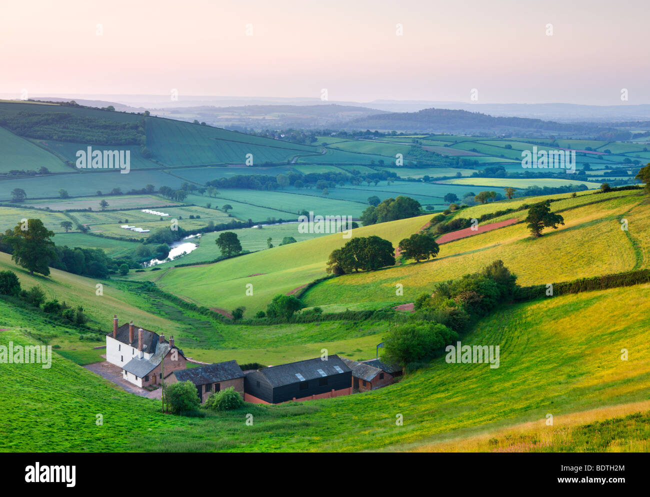 Farm nestled in the Exe valley overlooking the River Exe, Devon, England. Summer (June) 2009 Stock Photo