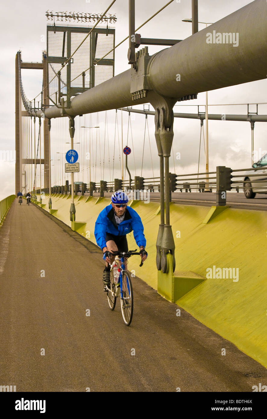 A cyclist crossing the Humber Bridge, North Lincolnshire - Stock Image