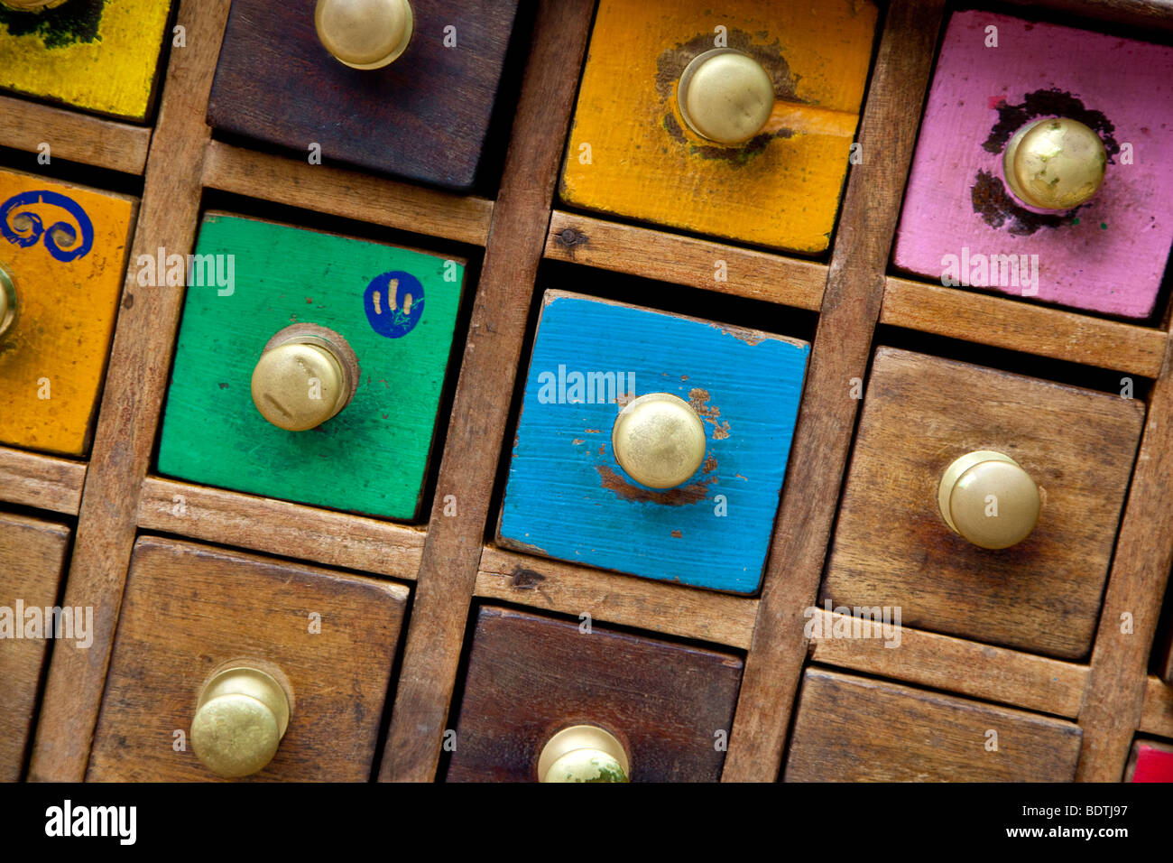 Coloured drawers The Eden Project Biome Cornwall England United Kingdom UK - Stock Image
