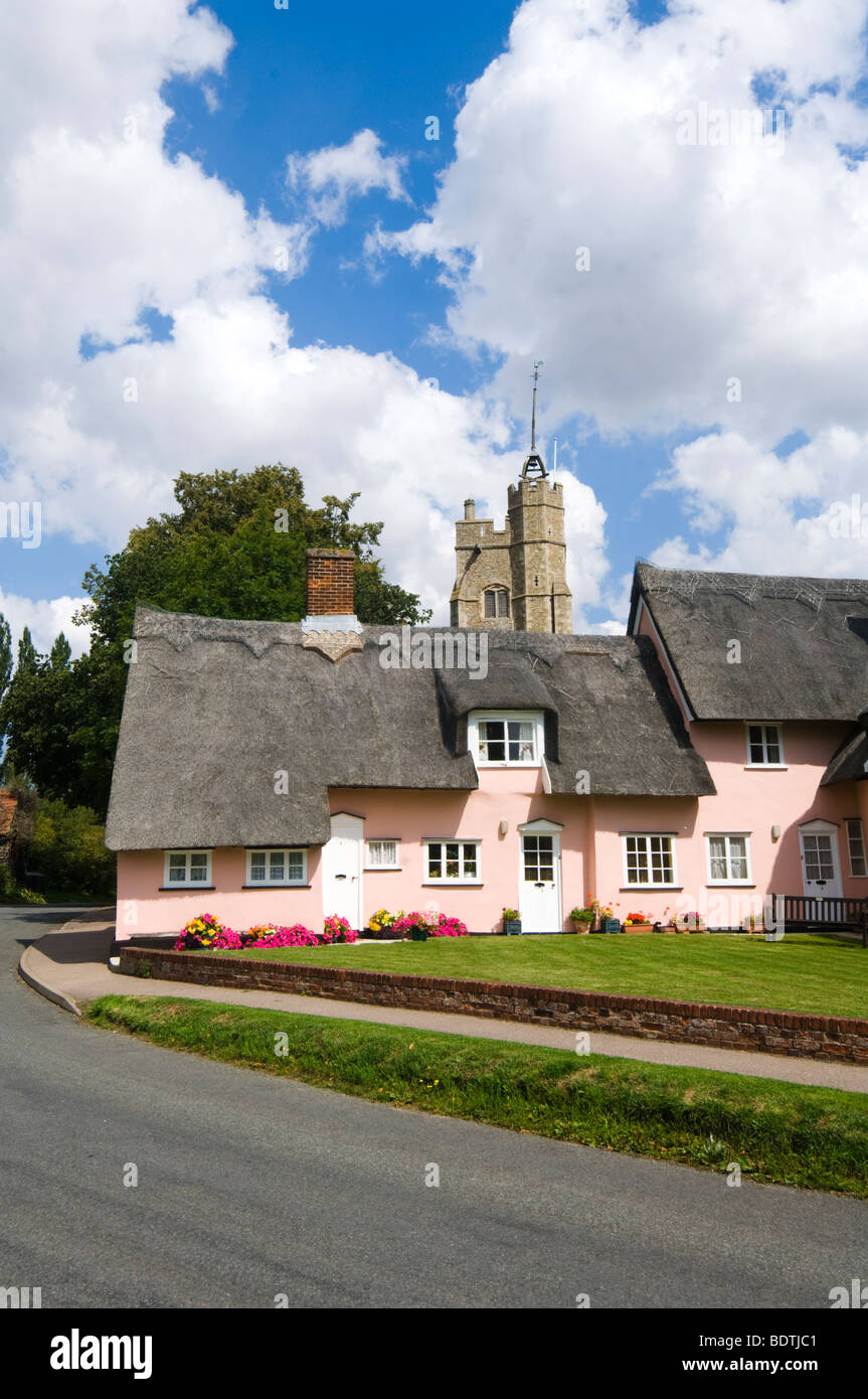 Thatched cottages and St Marys Church Cavendish Suffolk UK - Stock Image