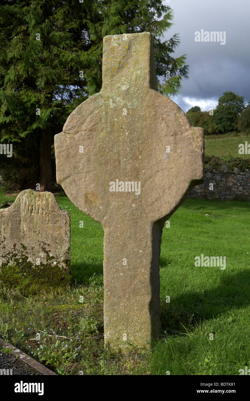 Errigal Keerogue cross unfinished celtic cross made of sandstone in the ruins of St Kierans church county tyrone - Stock Image