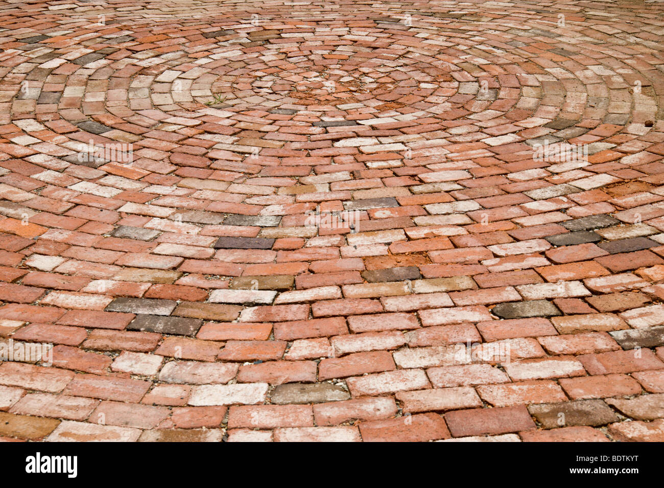A swirling pattern of bricks found in Carrizozo, New Mexico. - Stock Image