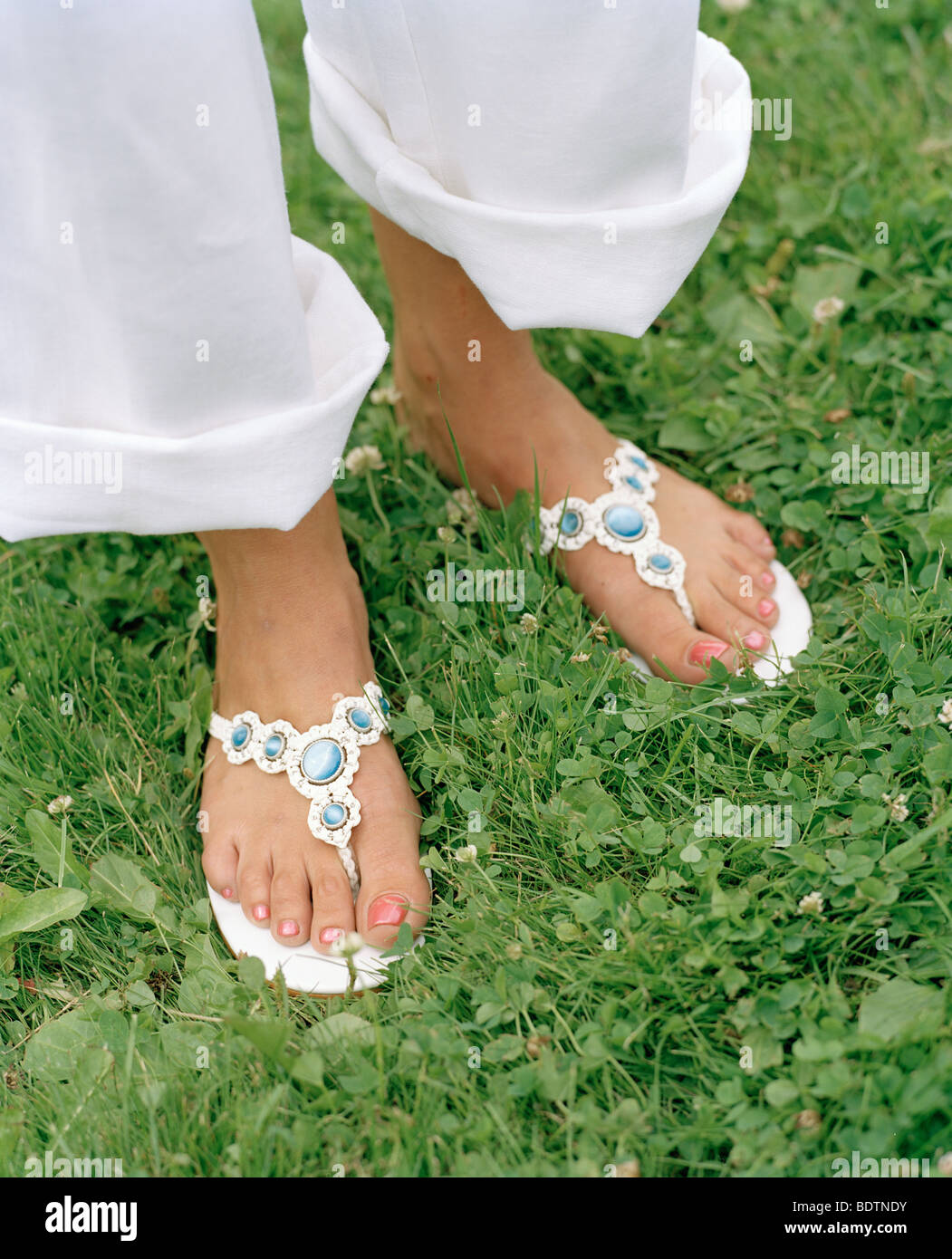 Feet wearing sandals - Stock Image