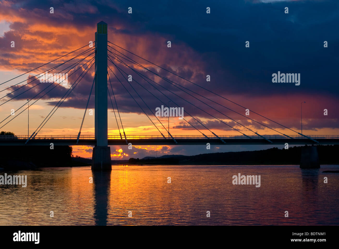 bridge over the the torne river at sunset, lapland, sweden Stock Photo