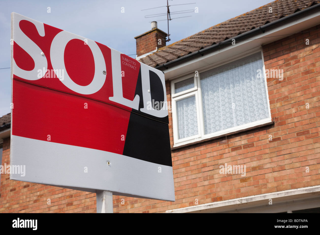 Estate Agent's sold sign board outside a residential house. Kent England UK Great Britain - Stock Image