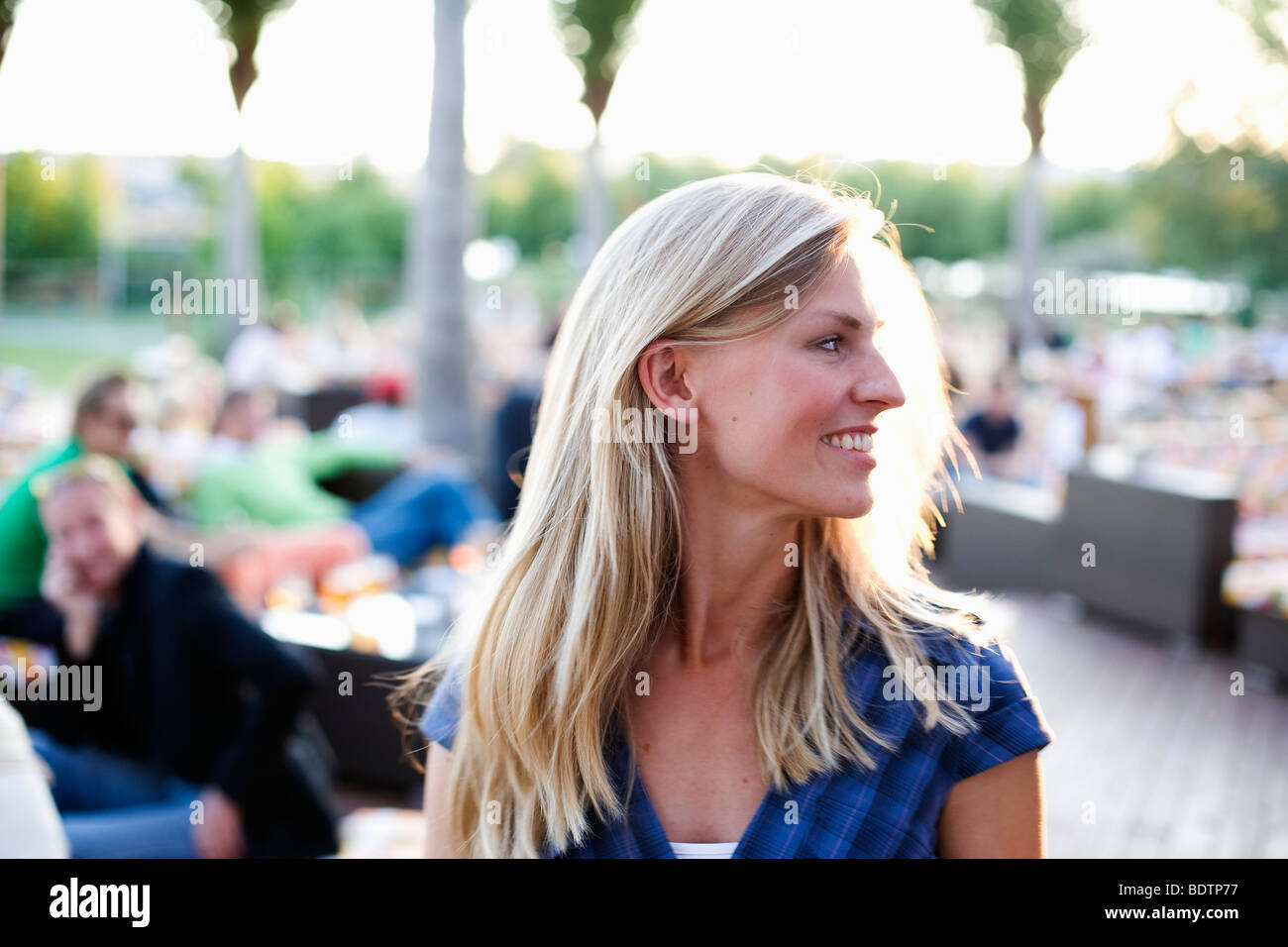 A young woman at an open-air caf - Stock Image