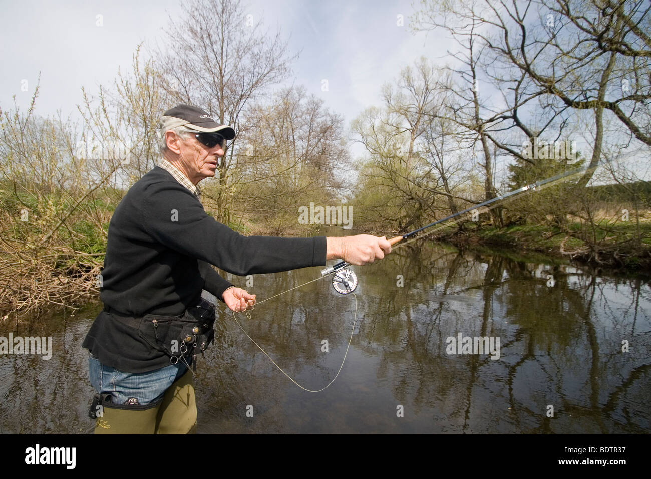 fly-fishing, fly-fischer, fishing rod and line, hinge, germany - Stock Image