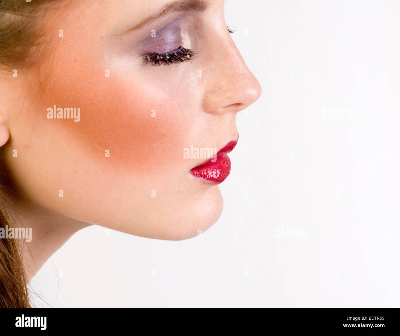 young woman, with artificial eyelid - Stock Image