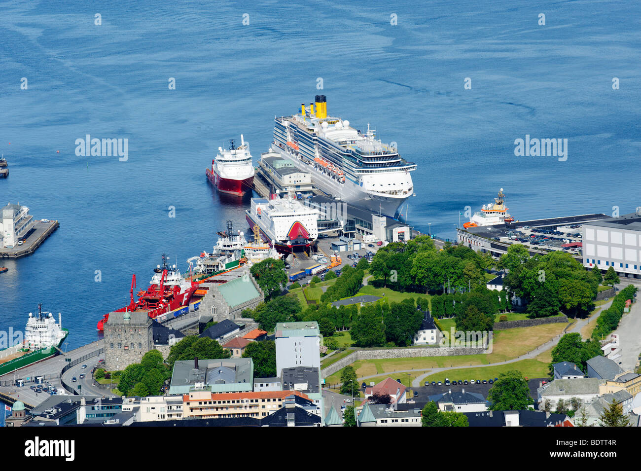 Cruise liner and Bergenhus fortress from the city hill and view point Floyen, Bergen, Norway, Europe - Stock Image