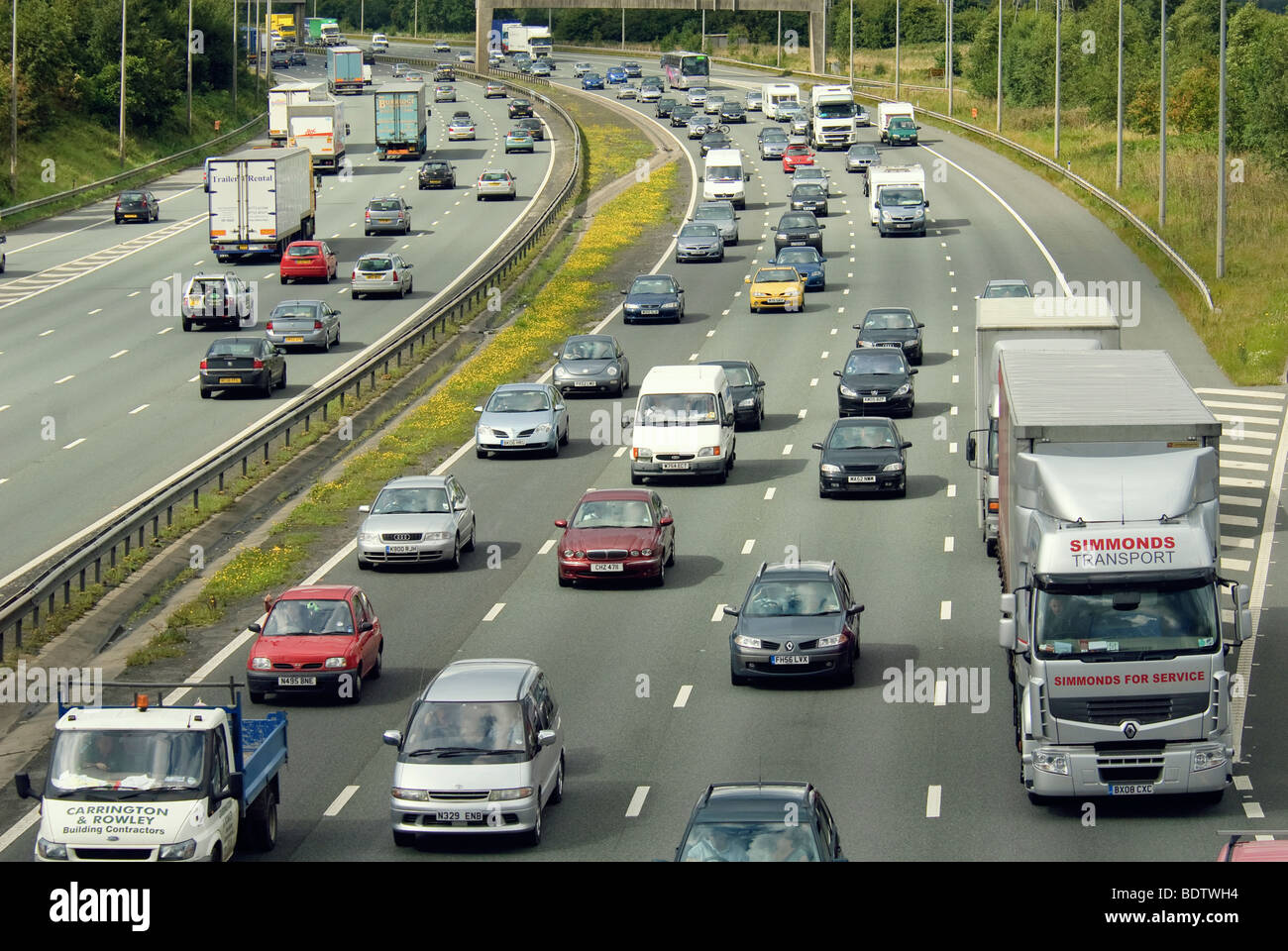 A build up of traffic on a British motorway. - Stock Image