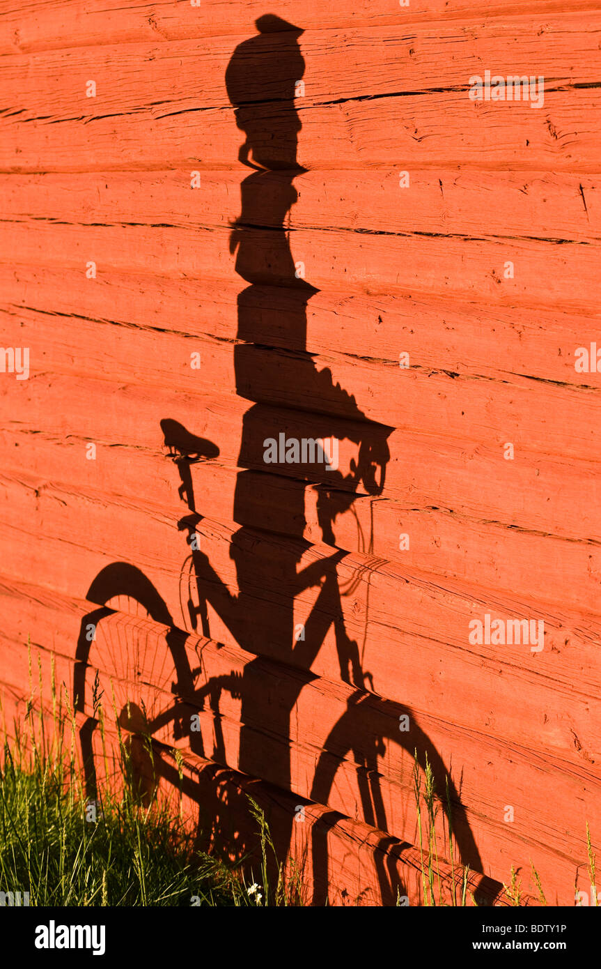shadow of cyclist on a stone wall, lapland, sweden Stock Photo