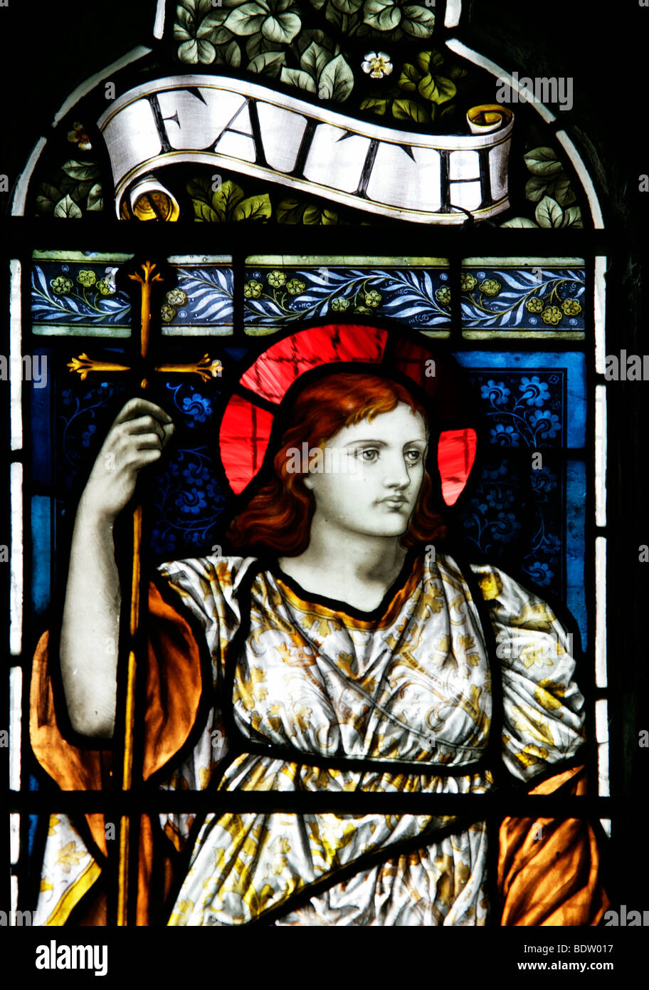 Stained glass window depicting Faith, Tintagel Church, Cornwall - Stock Image