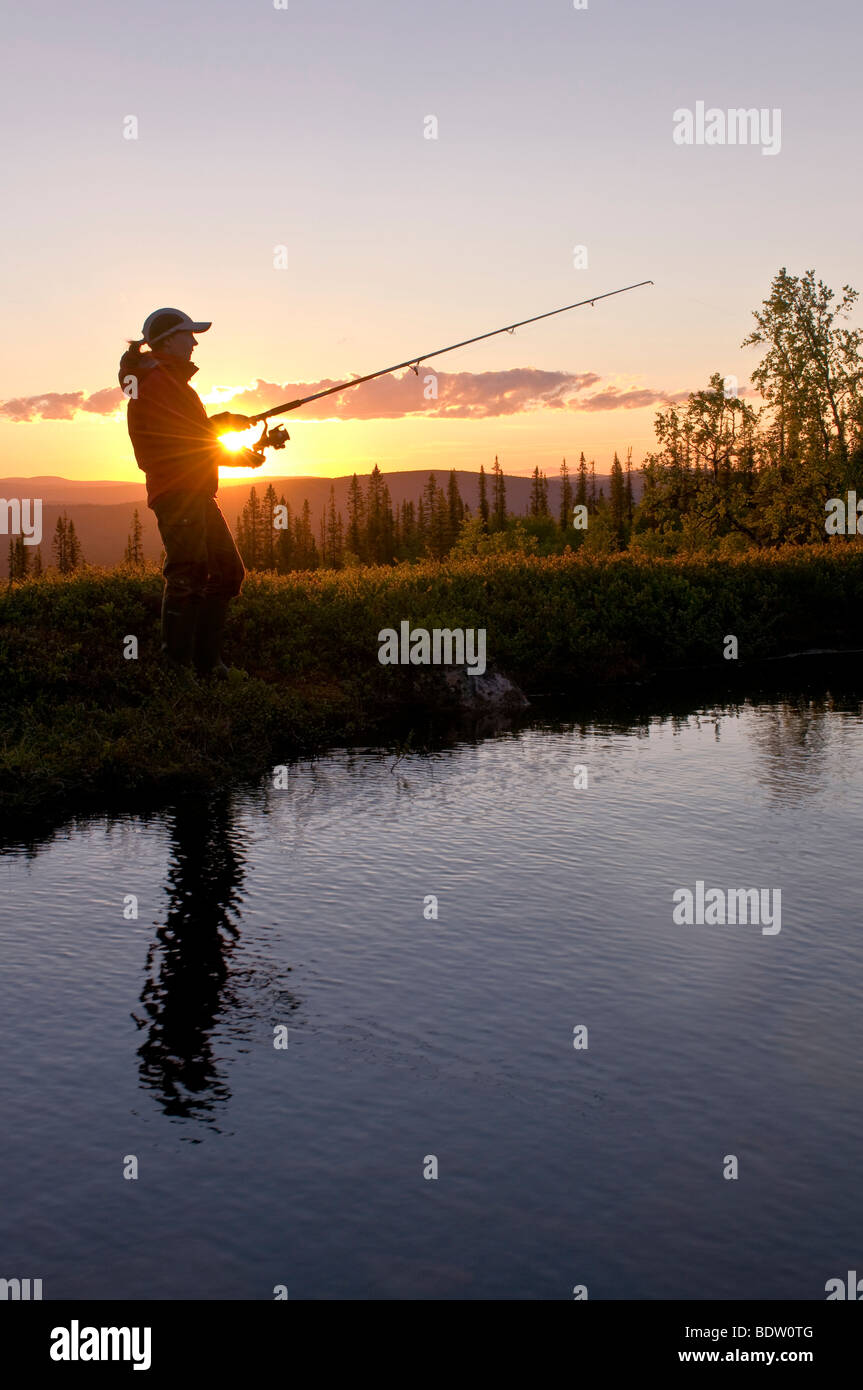fisher, midnight sun in lapland, sweden - Stock Image