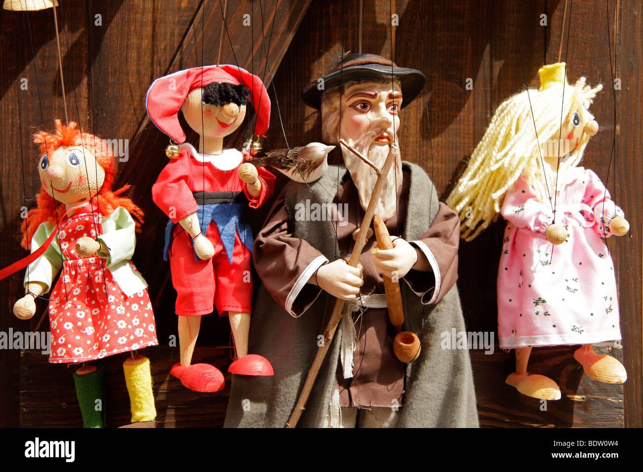 puppets on a string in a souvenir shop in Cesk Krumlov, Czech Republic, Europe - Stock Image