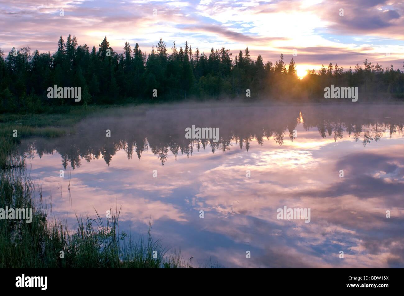 sonnenuntergang ueber see in lappland, schweden, lake at sunset in lapland, sweden Stock Photo