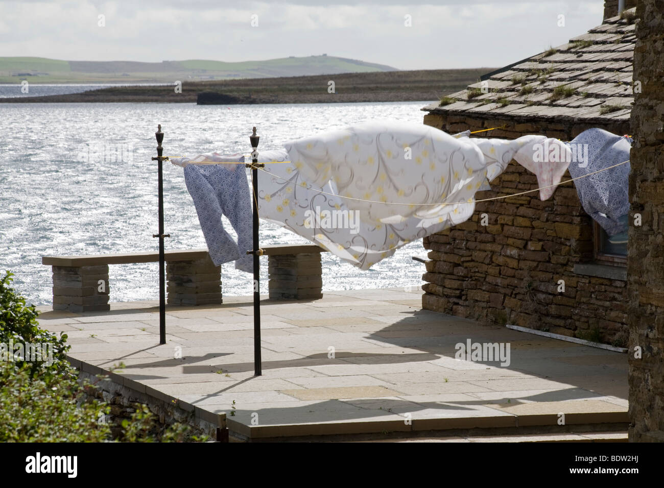 drying clothes on a terrace at the sea in stromness, orkney islands, scotland - Stock Image