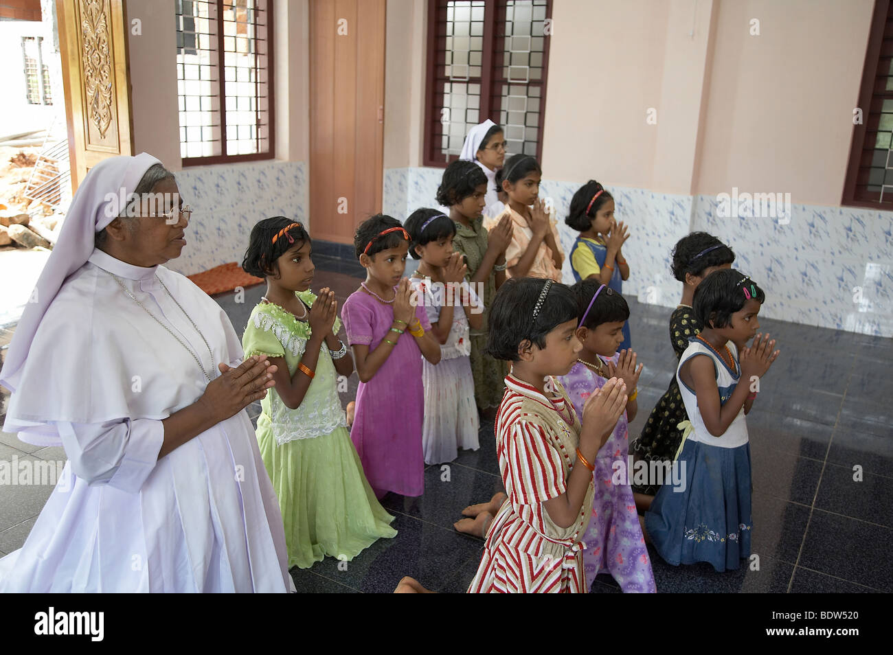 INDIA Nuns and girls at prayer  Mary Matha Bala Bhavan, a