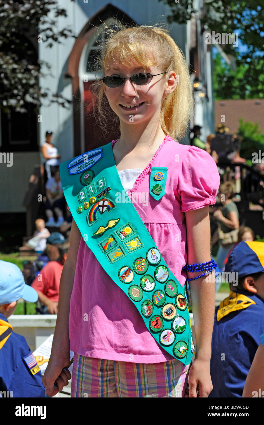 Proud Girl Scout Displays Badges in Patriotic Parade - Stock Image