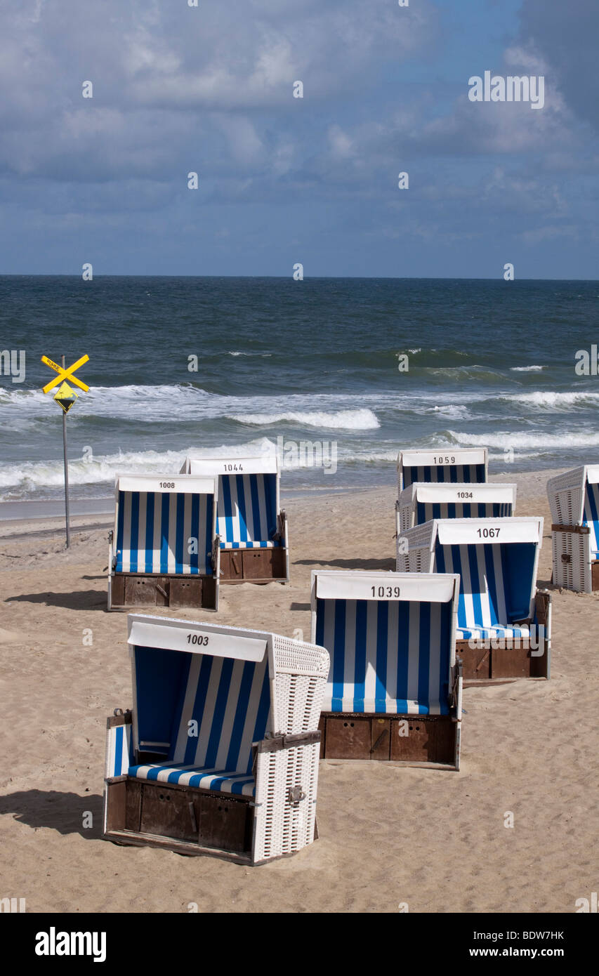 Empty beach chairs on Westerlaender beach, sign warning of the groynes, Sylt, Schleswig-Holstein, North Germany, - Stock Image