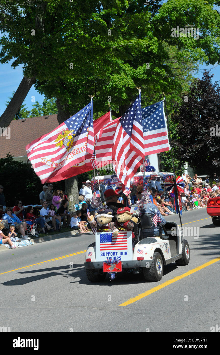 Veterans in golf carts in patriotic parade Stock Photo: 25755796 - on
