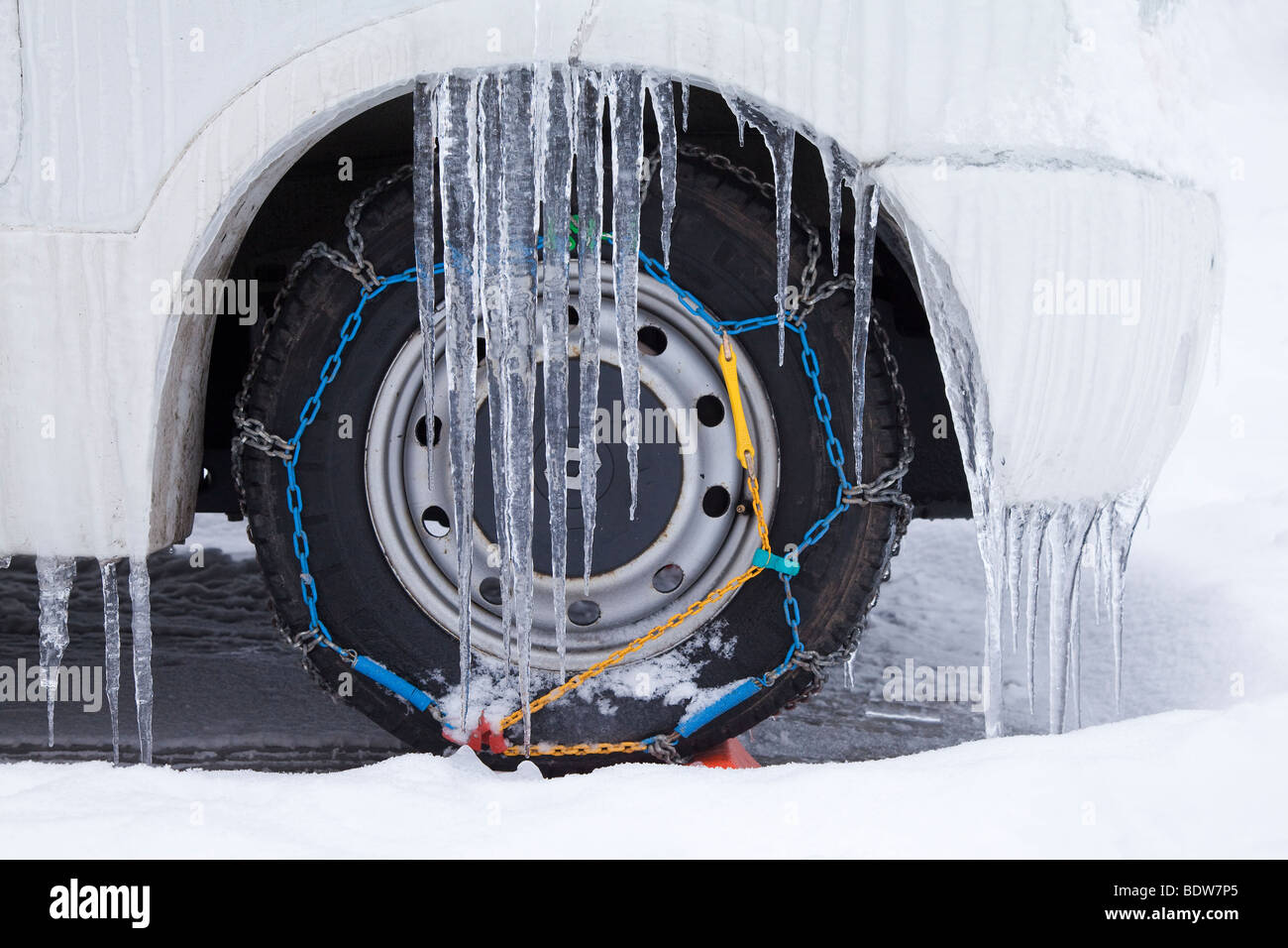 Camper van with Snow chains, winter snow, French Alps, France - Stock Image