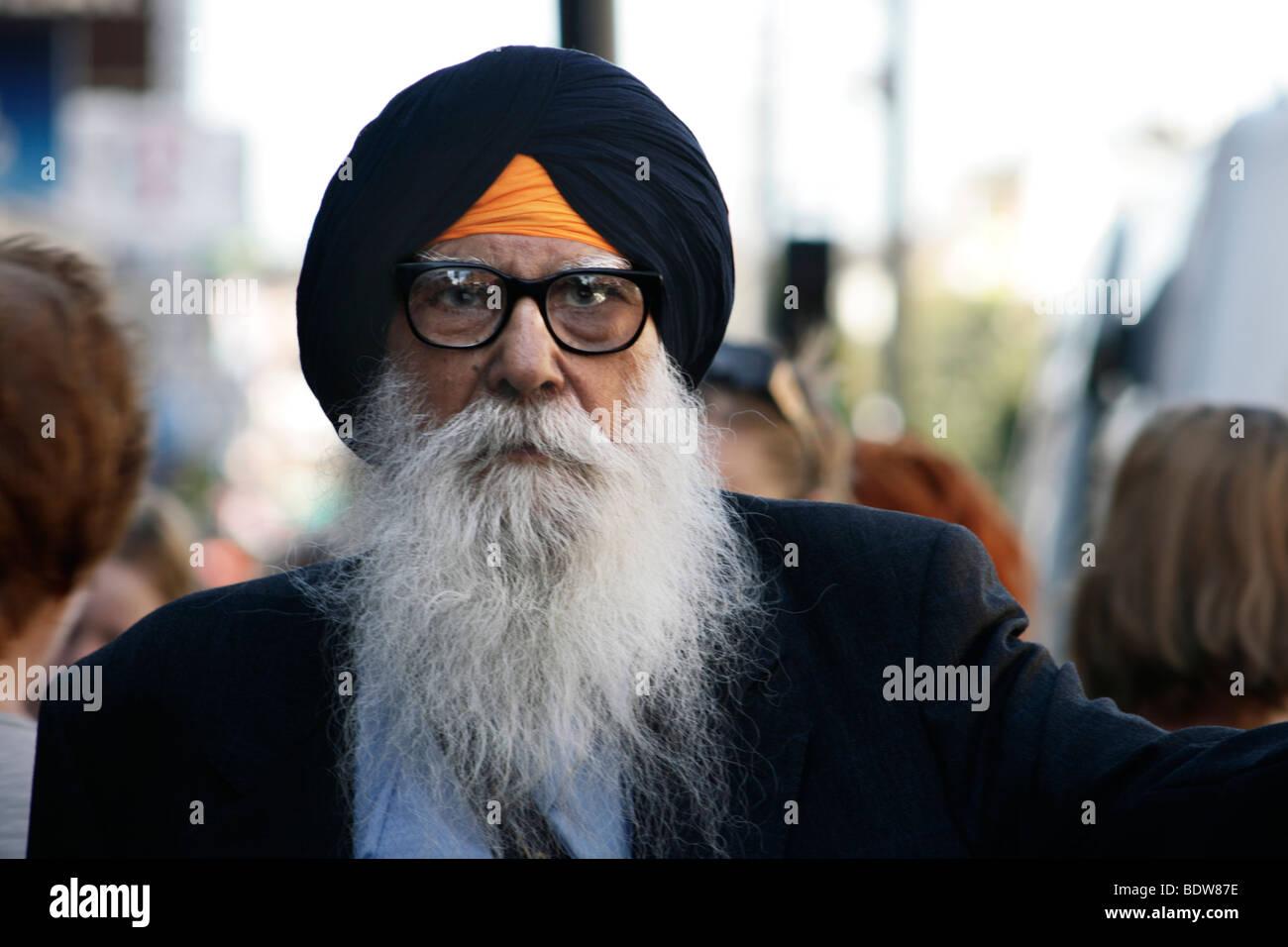 a Hinduist man walk around London - Stock Image