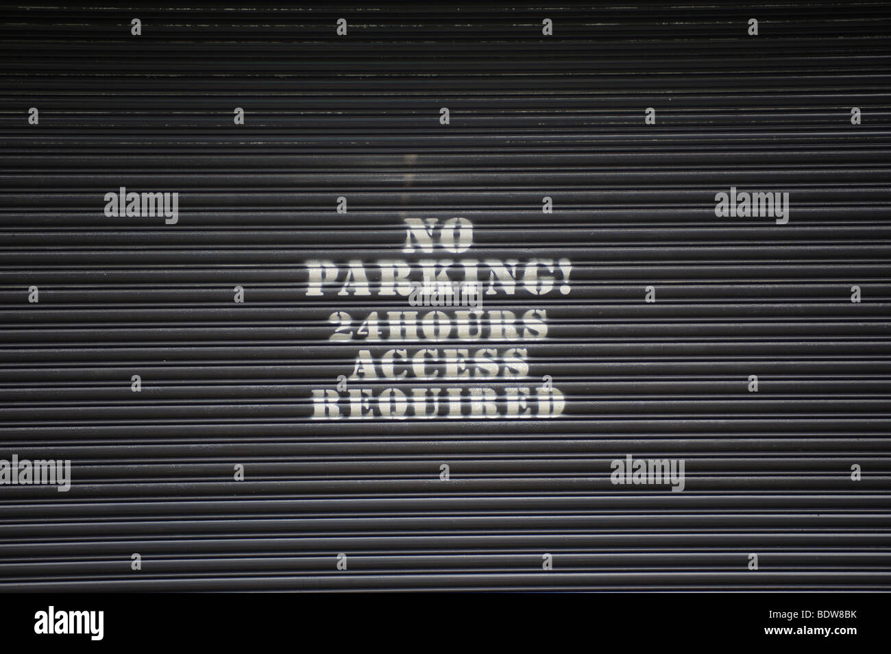 No parking sign on a garage door. - Copyright owned photograph by David J Colbran 0044 0 7810 321 634 - Stock Image