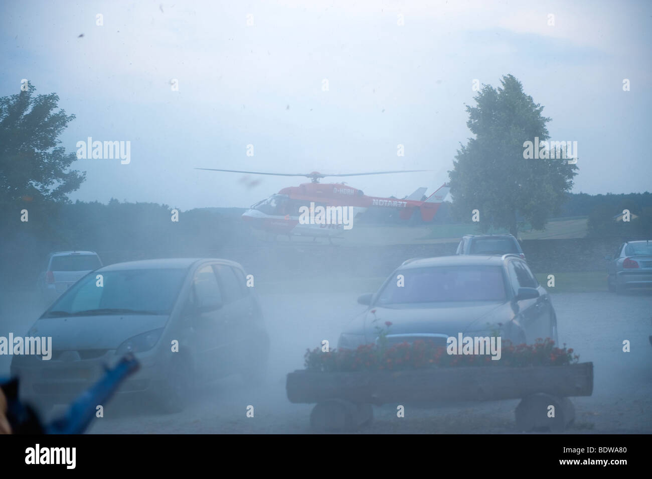 red rescue helicopter emergency doctor physician response rescue life saver lifesaver fly flying flight landing - Stock Image