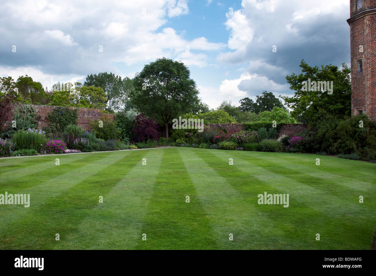 A cottage garden with an herbaceous border Stock Photo