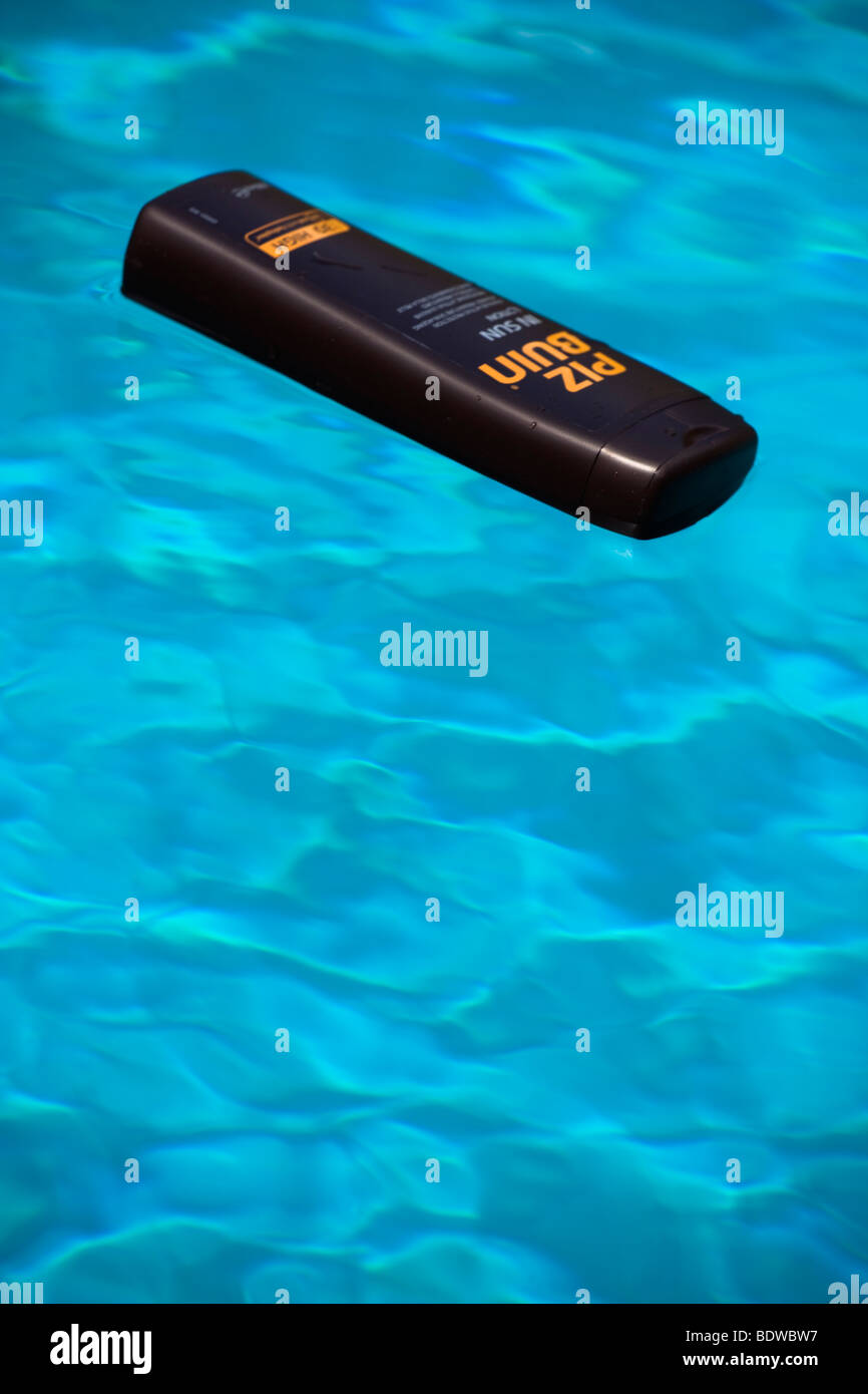selective focus image of suncream in a swimming pool - Stock Image