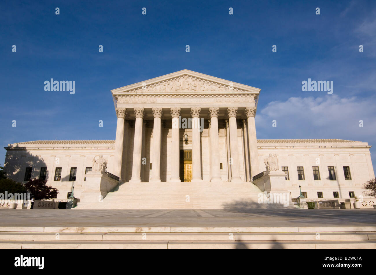 The steps of the United States Supreme Court building bathed in late afternoon sunlight. - Stock Image