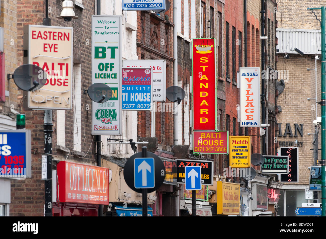 Indian and Bangladeshi restaurant signs on Brick Lane, Tower Hamlets, London, England, UK Stock Photo