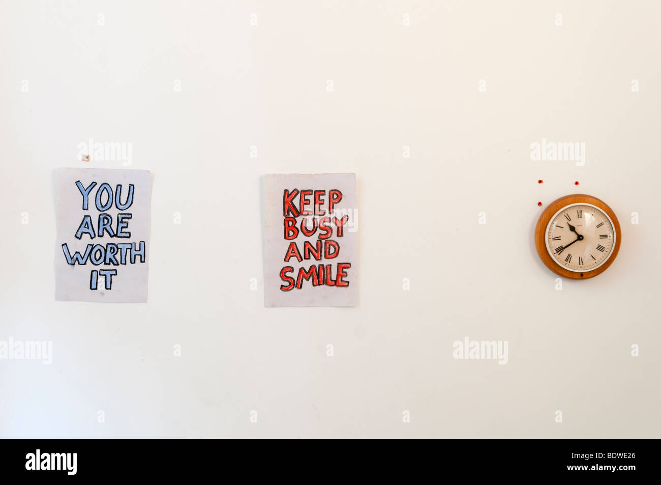 Motivational signs on wall of person suffering from depression, England, Britain, UK - Stock Image