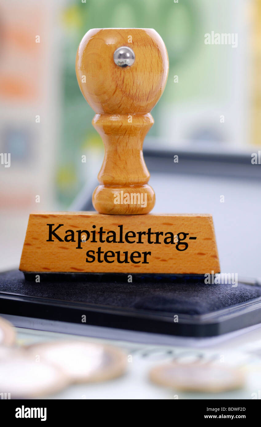 Stamp with the writing Kapitalertragsteuer capital yields tax Stock Photo
