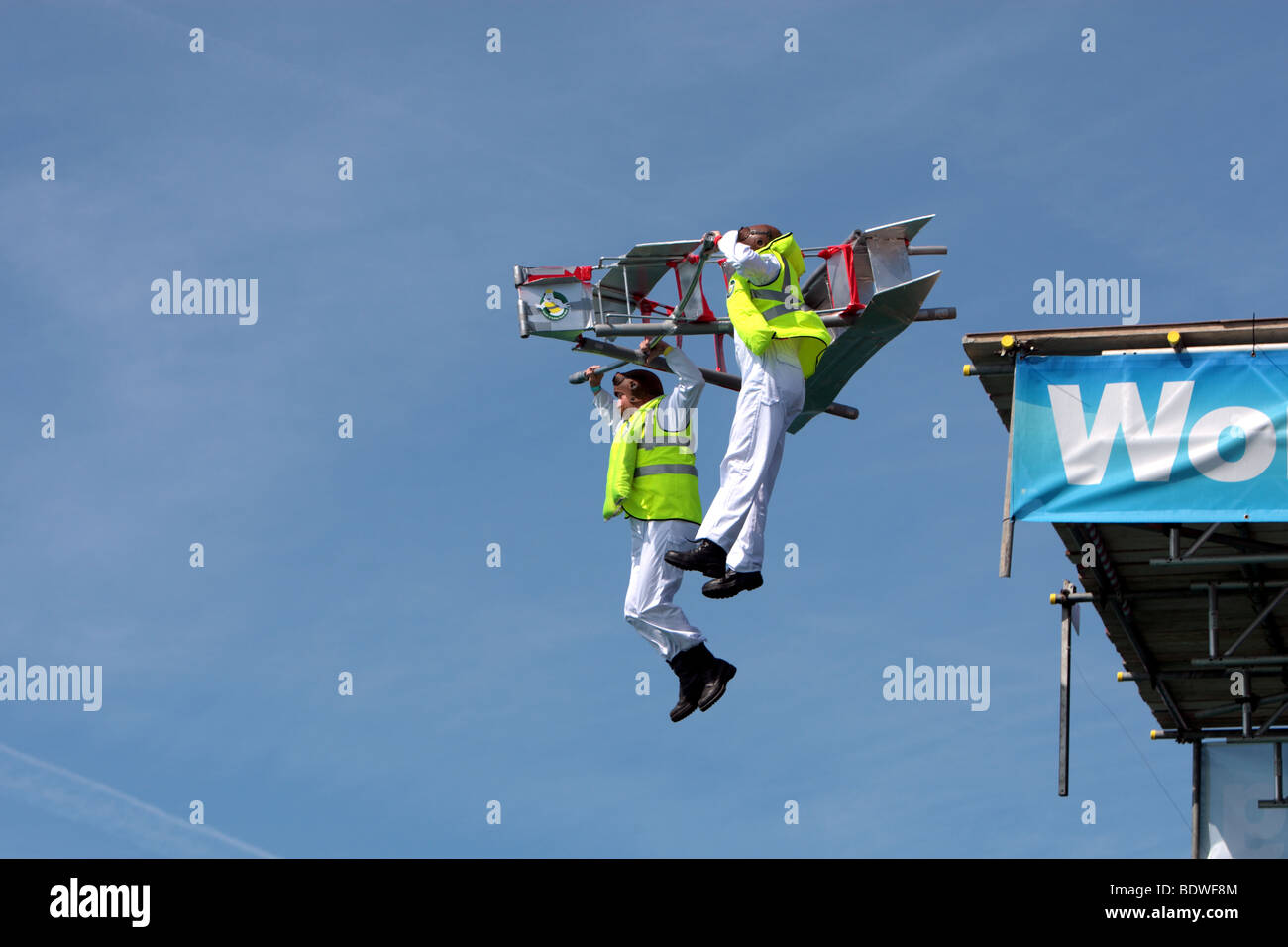 Two Health and Safety Officers Jump from Worthing Pier trying to fly a stepladder in Worthing Birdman Competition Stock Photo