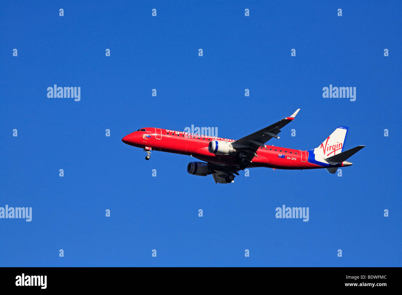 Virgin Embraer 190 Aircraft in flight - Stock Image