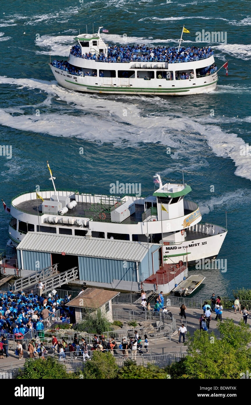 Maid of the Mist boat with Tourists - Niagara Falls, Canada - Stock Image