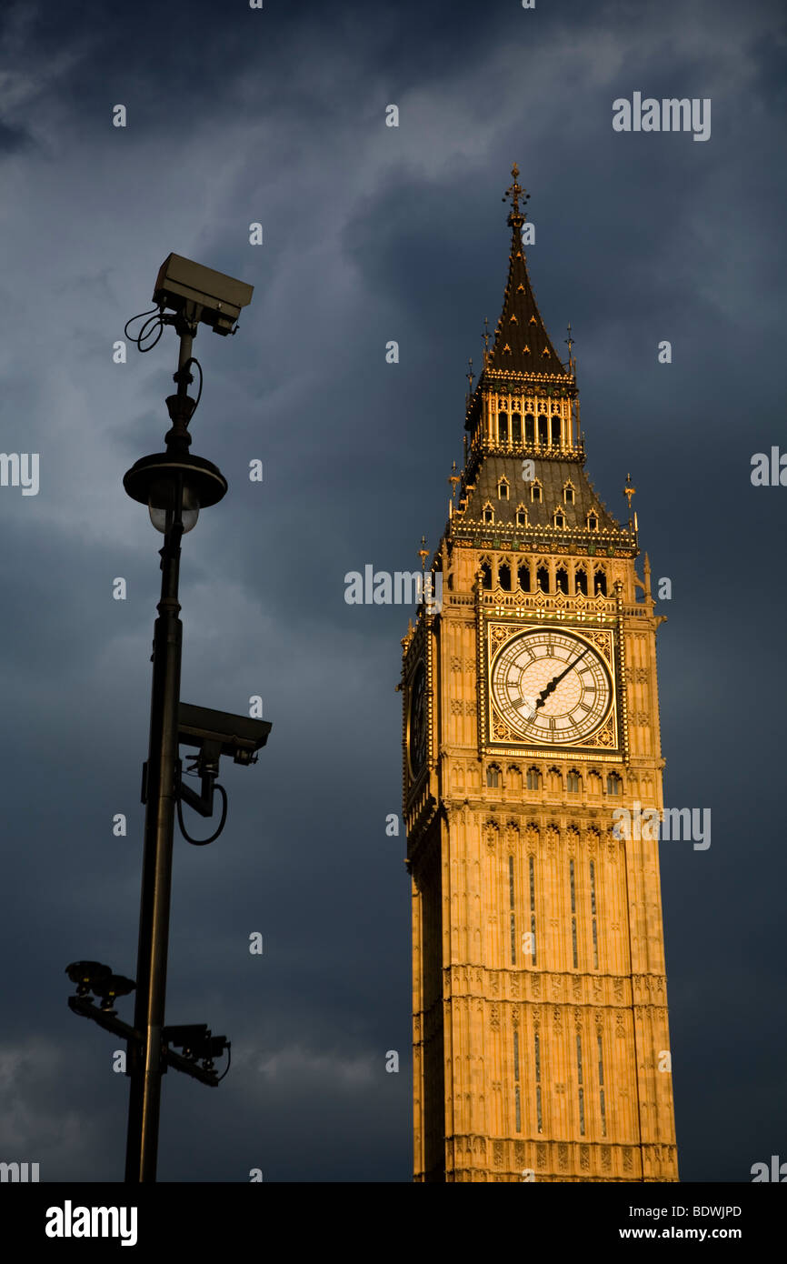 Big Ben and security cameras, in stormy and cloudy sky and weather, London, England, at sunset. Focus on security Stock Photo