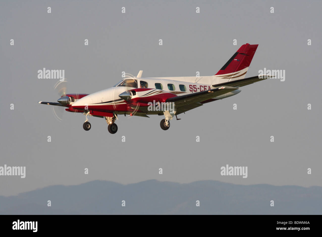 Beechcraft A60 Duke twin-engine light private plane on approach - Stock Image