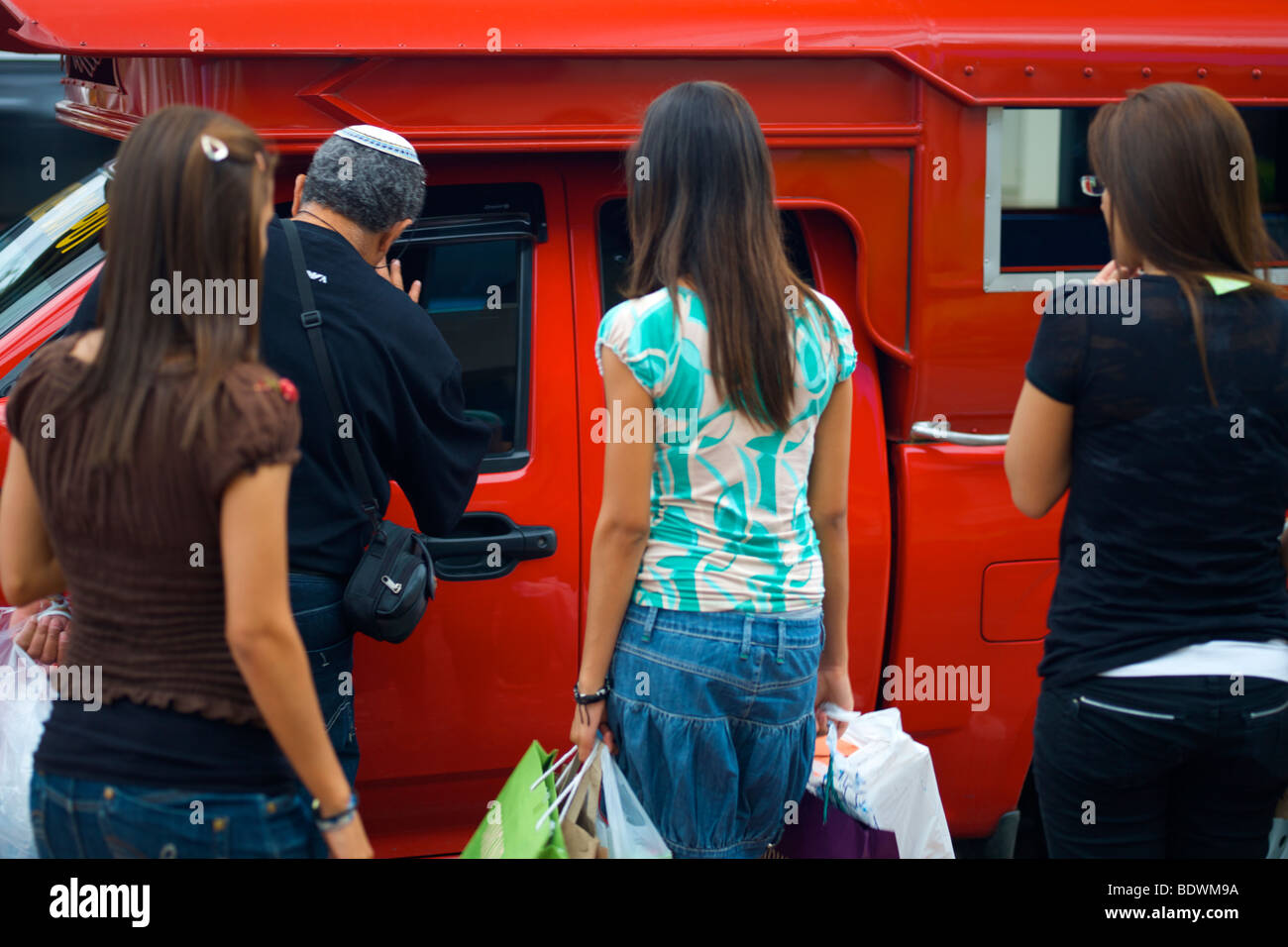 Tourists negotiate with songthaew taxi in Chiang Mai Thailand - Stock Image