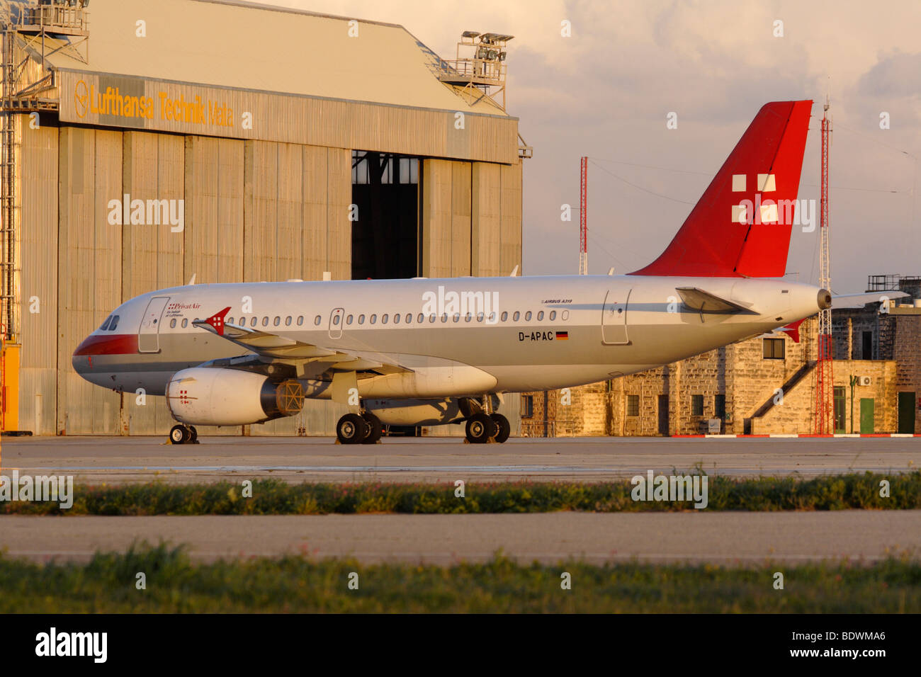 PrivatAir Airbus A319LR at Lufthansa Technik Malta - Stock Image