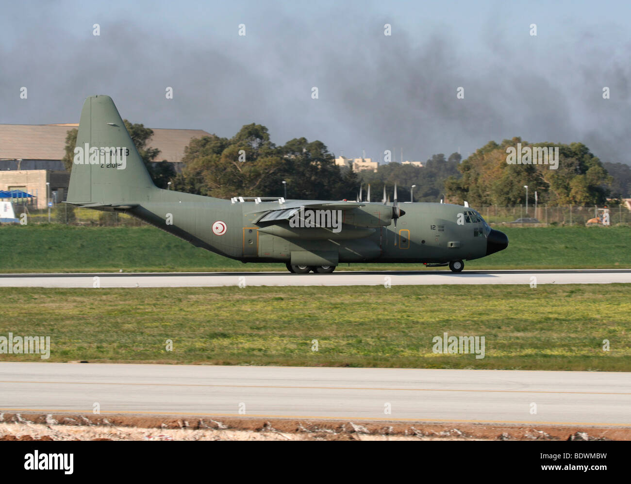 Tunisian Air Force Lockheed C-130 Hercules military cargo plane on the runway just after landing in Malta - Stock Image